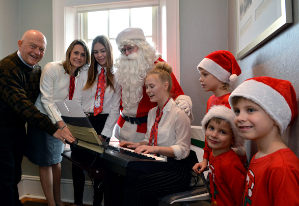 Santa and guests enjoying Christmas Carols at Heritage House Dental