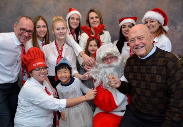 Santa with Mississauga Councillor Ron Starr and guests at Heritage House Dental